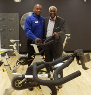 """L-R: Courtney Griffin, director of sports and fitness at the South Side YMCA,6330 S. Stony Island Ave. and Dr. Leon Finney, Jr., took part in the South Side YMCA's """"Big Reveal"""" Sept. 4, 2014, following a two-year, $3.6mm facility renovation."""