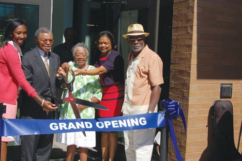 Mrs. Dian Jackson (center), the widow of Rev. John  H. Jackson, the Portland religious leader known for his activism in bringing positive change to the local African American community, cuts the ribbon to the John and Dian Jackson Center on the Portland Community College Cascade Campus in north Portland.  The center will provide new classrooms for Albina Head Start and Albina Early Head Start. Also participating in Friday's dedication ceremony is (pictured from left)  PCC Board Director Kali Thorne Ladd, former PCC Cascade Campus President Algie Gatewood, current Campus President Karin Edwards and Albina Head Start Board Chair Richard Brown.