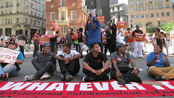 Nine Boston protesters were arrested during a fast food worker strike organized as part of a national fight for higher ...
