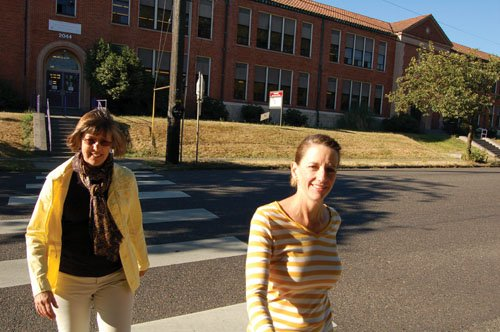 Portland Transportation Director Lea Treat (right) and transportation staff member Sharon White, participate Friday in a crosswalk enforcement action at Northeast Killingsworth Street and 22nd Avenue in front of Vernon Elementary School.