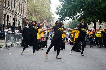 Performers from The Black and Gold Marching Elite showing off their skills at the 2014 African American Day Parade. Sept 21, 2014.