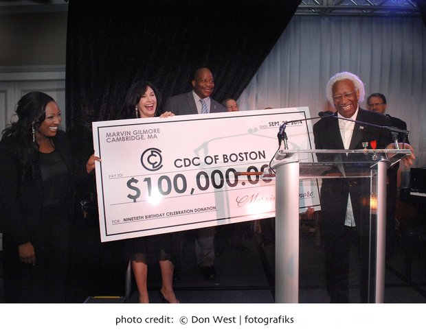 Marvin Gilmore gives a check to the CDC of Boston at his 90th Birthday Celebration