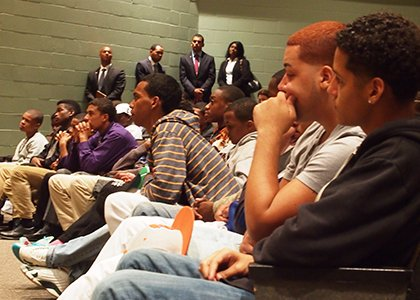 Boston school students listen to a panel discussion on the city's efforts to improve educational outcomes for black and Latino students. (Banner photo)