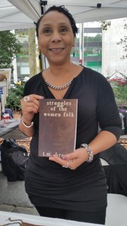 "T.M. Brown holding her book ""Struggles of the Women Folk."""