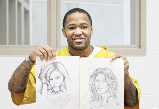 Sherod Jones displays sketches he has drawn to express himself at the Richmond Justice Center.