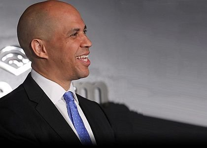 Democratic U.S. Sen. Cory Booker handily beat Republican challenger Jeff Bell on Tuesday to win a full six-year term.