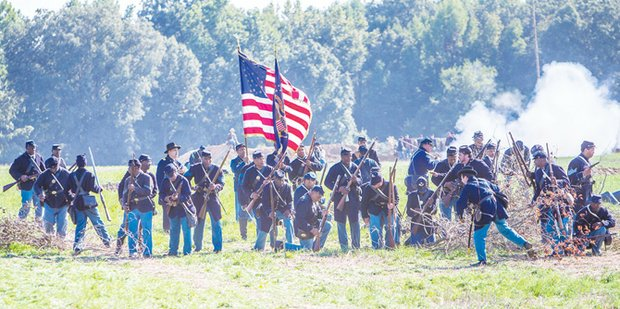 Re-enactment at historic New Market Heights, historic battle took place Sept. 29-30, 1864. Its significance: Fourteen members of the U.S. Colored Troops, from five different regiments, were awarded the Medal of Honor for actions during the battle.