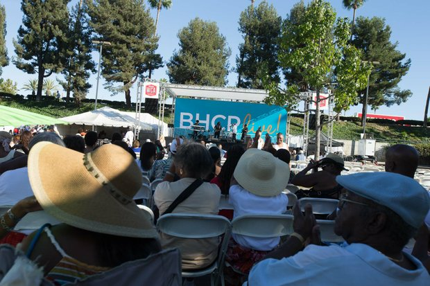 Spectators enjoy the shade as the Michael Ward band performs at IBEW Local 18 and Baldwin Hills Crenshaw Union Jobs Expo and Celebration featuring over 20 community organizations sharing information about job training opportunities.