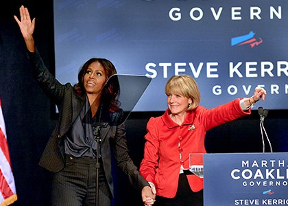 First Lady Michelle Obama joins Massachusetts Attorney General Martha Coakley on stage at the Strand Theatre in Upham's Corner during a campaign event. A host of elected officials turned out for the event in support of Coakley.