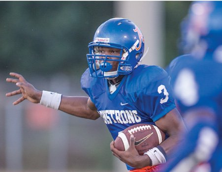 Armstrong quarterback De'Shaun Waller eyes an opening in the game against Varina.