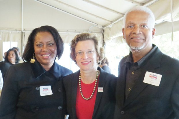 Mereda Davis Johnson (left) and U.S. Rep. Hank Johnson pose with Senate candidate Michelle Nunn during a fundraiser Oct. 6 at Green Ginger restaurant in Decatur.