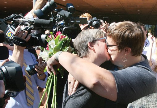 Nicole Pries, left, and Lindsey Oliver kiss after an impromptu ceremony outside the Downtown courthouse Monday. They became the first same-sex couple to wed in Richmond.