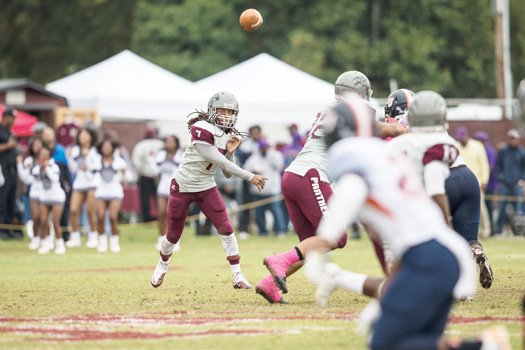 VUU quarterback Kenneth Graham fires off a pass at Hovey Field during the homecoming game against Lincoln University.