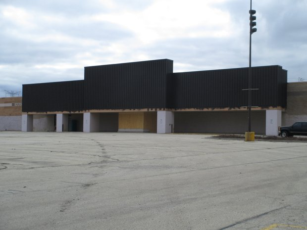 The overhang across the entrance to the former Cub Foods store at 191 S. Larkin Ave. has been painted a dark brown by the building's new owners, Harvest Bible Chapel Joliet.