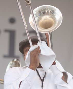 A member of the Bailey Hummingbirds Gospel Brass Band blows his trumpet.
