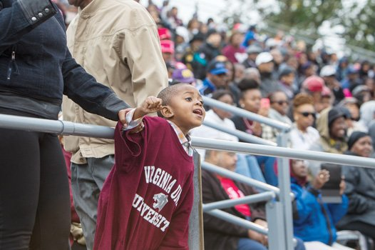 Three-year-old Trey Manley cheers on the Virginia Union University Panthers during their homecoming victory Saturday at Hovey Field.