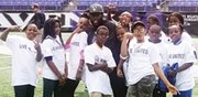 Baltimore Ravens safety Matt Elam with his team of kids at the Ravens Annual Team Challenge at M&T Bank Stadium on Monday, October 20, 2014. Selected students from Liberty Elementary School participated in challenges including: kickball, relay races and ultimate football under the guidance of Playworks Baltimore. The Ravens community-relations team spearheaded by Community Relations Manager Emily Scerba facilitated the activities during the event.