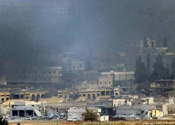 A Kurdish activist in Kobani said late Friday he saw more than 100 Kurdish fighters known as Peshmerga cross over ...