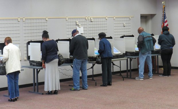 Voters cast Election day ballots on Nov. 4 at the busy polling place in the Wesley Chapel Library in Decatur.