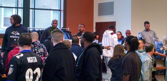 The Baltimore Ravens and the Lady Ravens Association teamed up for the 11th annual Ravens Coat Giveaway at the Helping ...