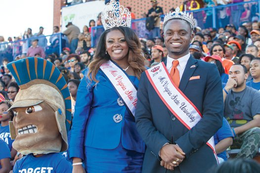 Machele Sanders, Miss VSU, and Danté Wright, Mr. VSU, flash winning smiles at Saturday's football game between the host Trojans and Lincoln (Pa.) University.