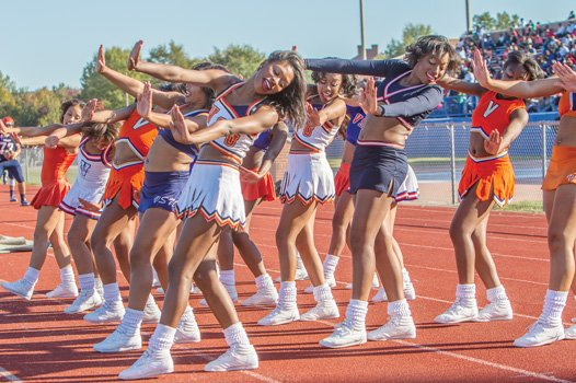 The Woo Woos, VSU's renowned cheerleaders, dazzle the fans with their smooth moves.