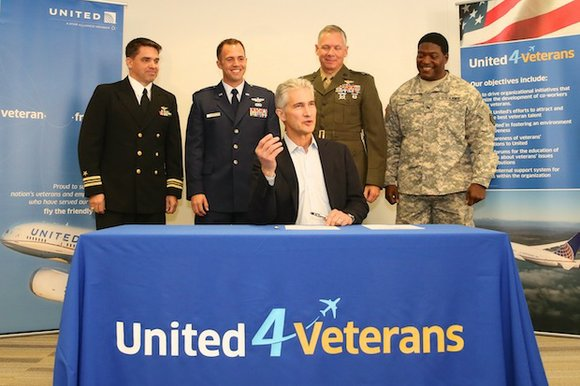 Flanked by veterans and members of the uniformed services, United Airlines Chairman, President and Chief Executive Officer Jeff Smisek today ...