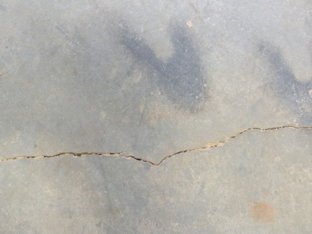 Cracks in the floor of the new senior center on Candler Road will be fixed before it opens in the spring.
