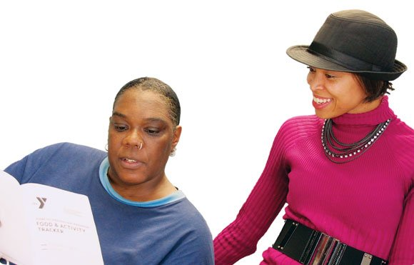 Almetta Cooper (l) gets advice from Ericka Florence, coach of the YMCA's Diabetes Prevention Program at the Roxbury Branch