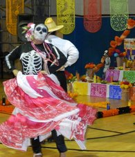 Dancing at Day of the Dead celebrations.