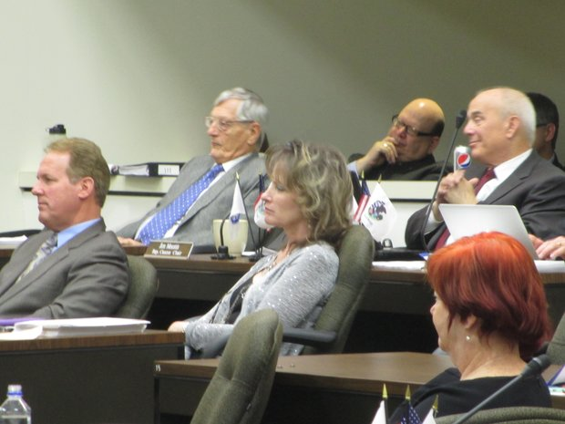Several Republican Will County board members listen to the debate over increasing the property tax at last week's county board meeting.