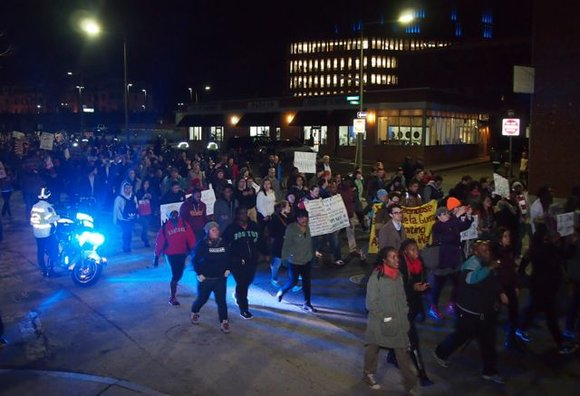 A crowd estimated between 3,000 and 5,000 people marched from Dudley Square to the South Bay House of Correction, blocking ...