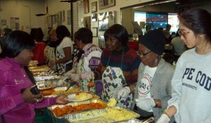 Volunteers serve food at the Rev. Al Sharpton's National Action Network annual Thanksgiving community dinner.