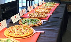Inside the Pizza Hut test kitchen, the company lined a long table with about 11 new pies. They looked appetizing, ...