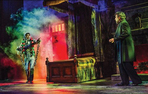 John San Nicolas as the Ghost of Jacob Marley and Craig Cackowski as Scrooge in Portland Center Stage's deranged comedy ...