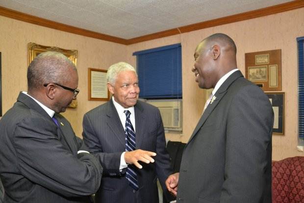 Attorney Benjamin Crump had this exchange with Fred L. Davis (center), first African American to serve as chairman of the Memphis City Council, and Bishop David Hall, pastor of Temple Church of God in Christ, during a Memphis visit (Feb. 28) that included Crump receiving the church's Community Award. (Photo: Tyrone P. Easley)