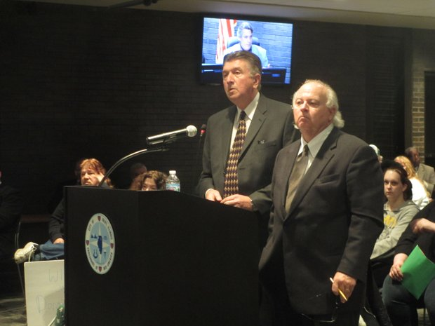 Randy Green (left), general manager of the Rialto Square Theatre, and Jim Smith, chairman of the Rialto's governing board, the Will County Metropolitan Exposition And Auditorium Authority, spoke to the Joliet City Council in mid-December about the new marquee proposed for the downtown Joliet theater.