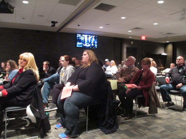 Audience members opposed to the new sign proposed for the Rialto Square Theatre listen as General Manager Randy Green speaks about the marquee with the Joliet City Council Monday night.