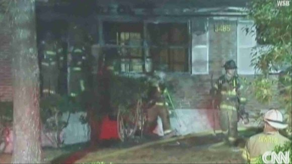 Firefighters arriving shortly after 11 p.m. Friday found three of four sides of a Decatur, Georgia, home on fire, according ...