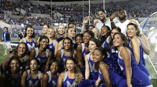 With the Tigers turning in a bowl-eligible season, there has been plenty to celebrate. Getting in on the fun during the Middle Tennessee State University game was former Grizz star Rudy Gay (left), who now plays for the Sacramento Kings, and his former Memphis teammate Quincy Pondextor. The two take a selfie with the University of Memphis dance team Memphis Palms. (Photo: Warren Roseborough)