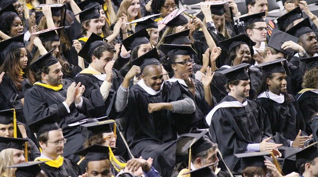 Virginia Commonwealth University students celebrate during the fall commencement ceremonies Saturday at the Siegel Center.