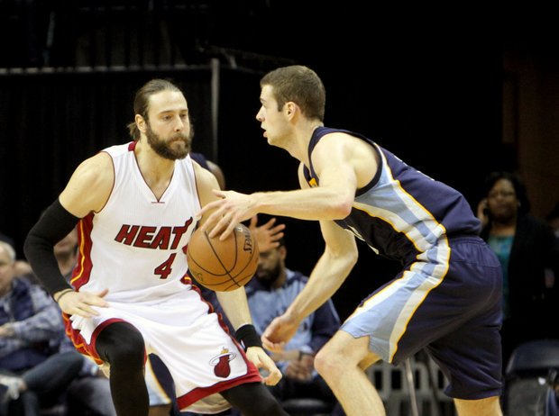 Jon Leuer of the Grizzlies drives around Josh McRoberts of Miami. The Grizzlies defeated the Heat 103-87 at the FedExForum on Sunday night. (Photo: Warren Roseborough)