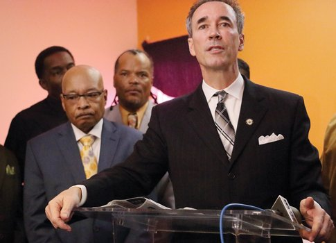 Delegate Joe Morrissey of Henrico County addresses the congregation Sunday at New Kingdom Christian Ministries in Highland Park as the church's pastor, the Rev. Leonidas Young II, left, listens. Rev. Young, a former Richmond mayor, served time in prison after being convicted in 1999 of fraud and influence peddling.