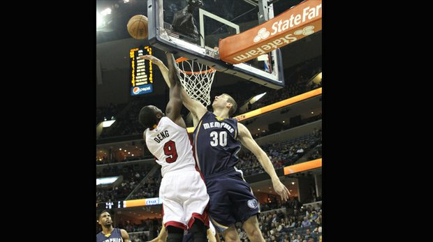 Jon Leuer of the Grizzlies blocks the shot of Luol Deng of the Heat. (Photo: Warren Roseborough)
