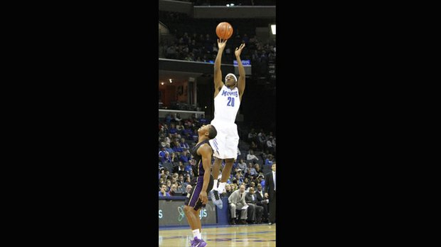 Avery Woodson of the University of Memphis Tigers drills a three pointer over John Brisco of Prairie View.  (Photo: Warren Roseborough)