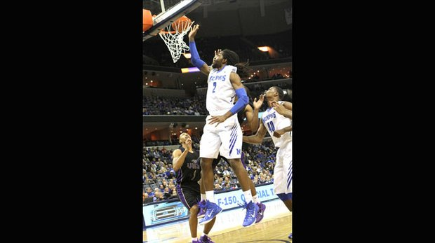 Shaq Goodwin of the Tigers tips in his own miss over Jayrn Johnson of Prairie View. (Photo: Warren Roseborough)