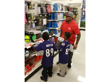 Baltimore Ravens Wide receiver Steve Smith Sr. hosted the 10th annual Holiday Helpers event Monday, December 15, 20014, at the ...