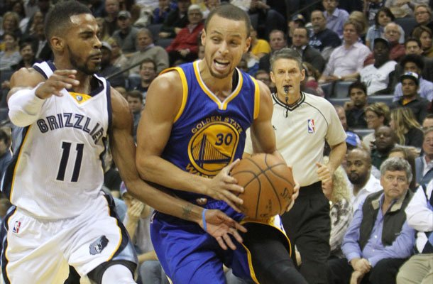 Mike Conley of the Memphis Grizzlies plays tough defense on Stephen Curry of the Golden State Warriors. (Photo: Warren Roseborough)