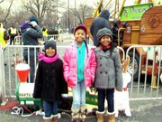 L-R: Jada Reid, 6; Amaya McClain, 10 and Nikaila Reid, 8, enjoyed Prologue Inc.'s Holiday celebration on Saturday, Dec. 20, 2014.