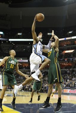 Vince Carter flies in for a dunk over Rudy Gobert of Utah, drumming up visions of the spectacular throwdowns that have punctuated his NBA career. (Photo: Warren Roseborough)